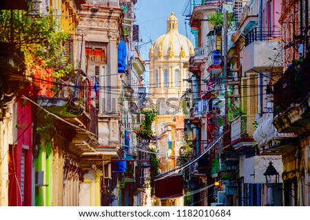 Colorful street in Old Havana with the Presidential Palace on the background #1182010684