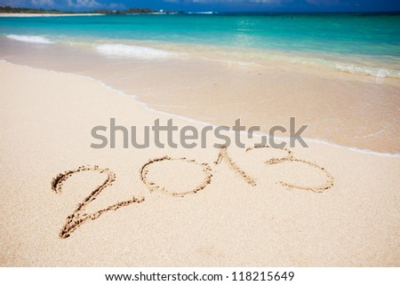 "New year background of beach with ""2013"" handwritten in the sand, holiday christmas concept #118215649"
