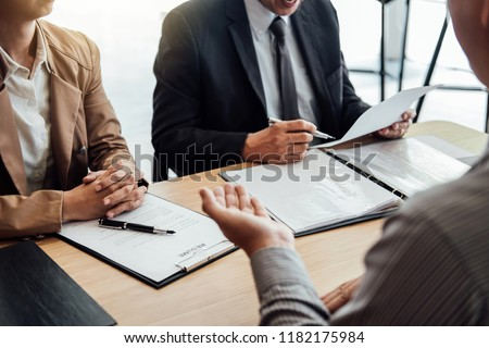 Business man explaining about his profile to two senior manager sitting in during job Interview, interview the job and hiring. #1182175984
