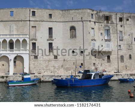a facade and quay in Polignano a Mare with boats and fishing gear #1182176431