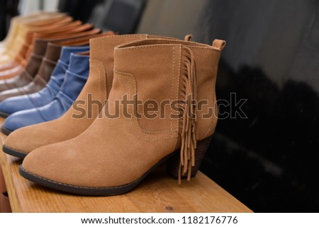 Shoe shop leather boots collection on shelves  #1182176776