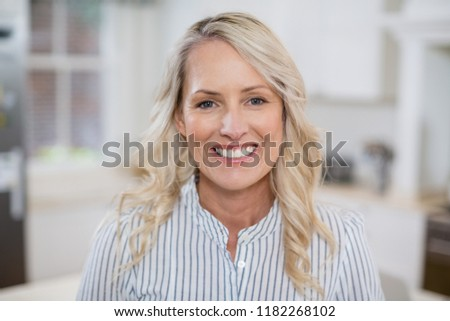 Portrait of beautiful woman smiling at home #1182268102