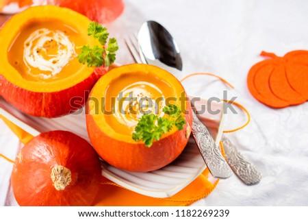Pumpkin soup served in a hollowed pumpkins #1182269239