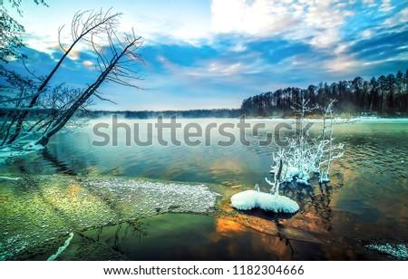 Winter forest lake landscape. Fog lake in winter snow forest. Winter snow forest lake panorama. Winter snow forest lake view #1182304666