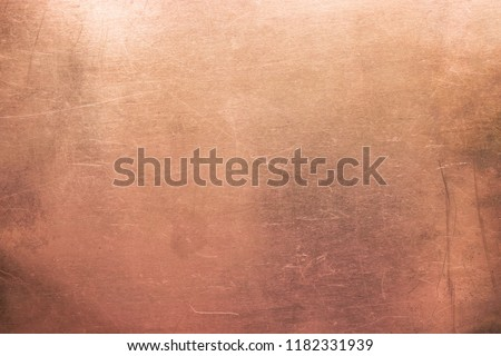 Old brass or copper background, texture of a vintage orange metal plate #1182331939