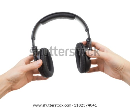 Headphones in hands on a white background #1182374041