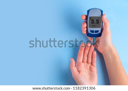 The diabetic measures the level of glucose in the blood. Diabetes concept. Copy space. Diabetes  #1182391306