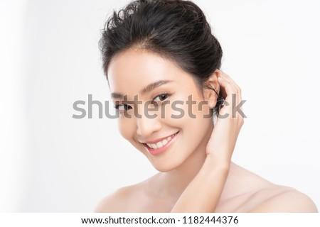 Beautiful woman asian face close up studio .She is catching hair