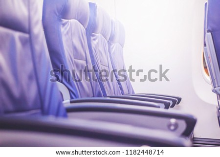 Chair a plane Passenger Blue Daylight, natural light. #1182448714