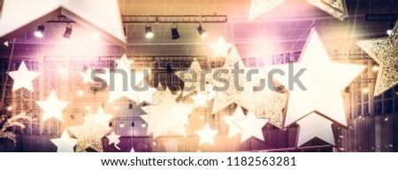 Stars spotlights soffits as finest hour celebrity show stage background with golden pink lights