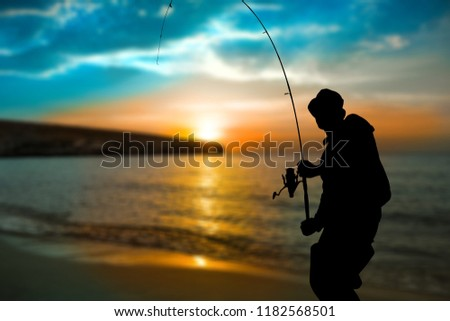 Silhouette of fishing man on coast #1182568501