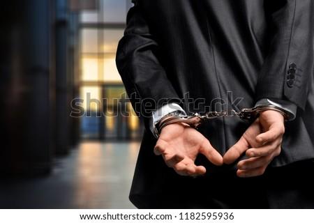 Arrest bound bracelet bribe bribery business businessman #1182595936
