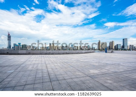 empty square with city skyline in wuhan china #1182639025