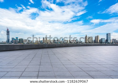empty square with city skyline in wuhan china #1182639067