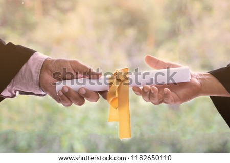Give and Recieved. The Professor sending a roll of certificated card to the student. #1182650110