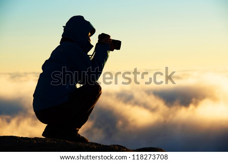 Nature photographer shooting in the mountains