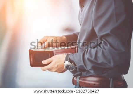 man hands holding wallet,empty wallet Royalty-Free Stock Photo #1182750427