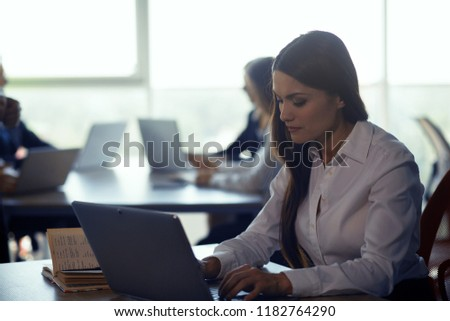 Businesswoman typing message on laptop. Having chat with partner abroad. Business concept. #1182764290