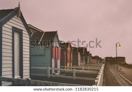 Westward Ho! beach huts along water front. Royalty-Free Stock Photo #1182830215