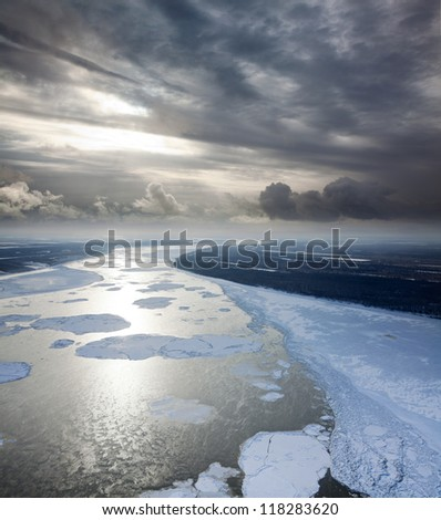 Aerial view of the great river with floating ice floes during sundown. Drifting of ice. Driving of ice. Ice floe. #118283620