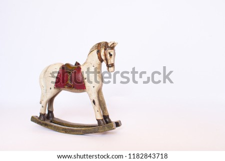 Toy rocking horse isolated on white background. Copy space.