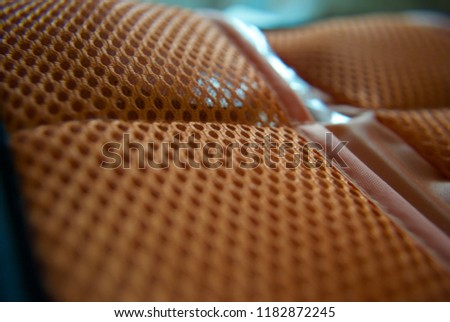 a orange background with holes #1182872245