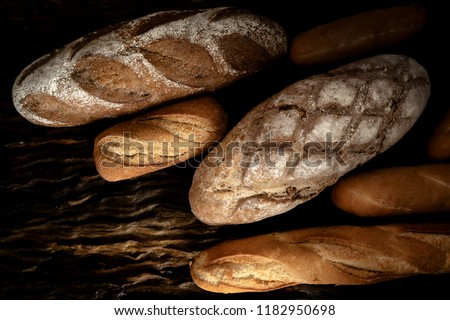 variety kinds of bread on wooden plank in dark tone #1182950698