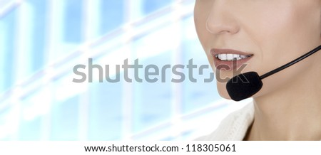Call center woman with headset against abstract background #118305061