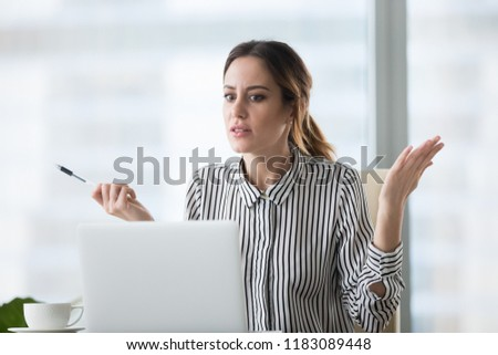 Confused businesswoman feel at loss looking at laptop screen with error message, frustrated female worker shocked by computer malfunction or online problem, seeing notice about pc crash or bad news #1183089448