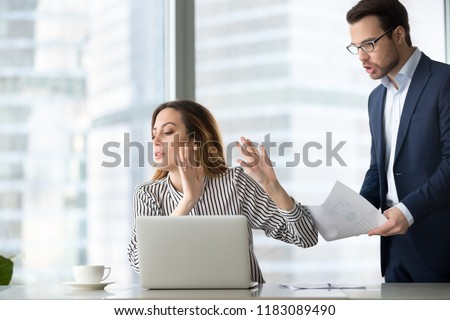 Tired bothered businesswoman abstracting from work refuse accept or consider report, annoyed female ceo gesturing rejecting mad business client or subordinate not looking at papers or documents #1183089490