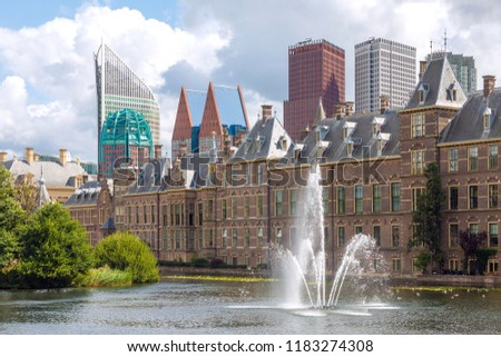 City center view of The Hague in Netherlands with pond Hofvijver and historical Binnenhof in foreground and modern skyscrapers in bakground #1183274308