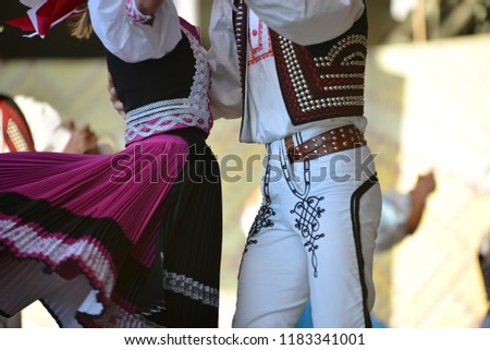 Hungarian National costumes. Dancers on stage #1183341001