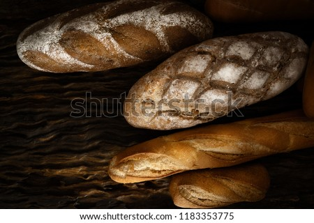 variety kinds of bread on wooden plank in dark tone #1183353775