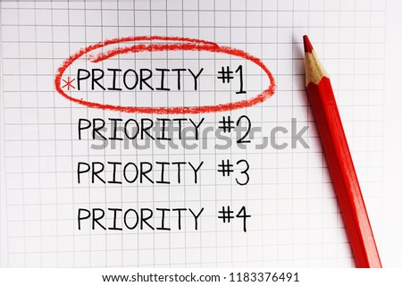 Number one priority marked with red circle on math notebook                                #1183376491