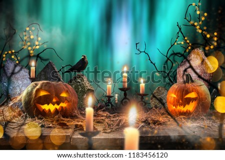Halloween pumpkins on wooden planks with spooky background. #1183456120
