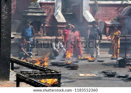 KATHMANDU - NEPAL / 04.26.2102: Hindu people praying at the temple in Kathmandu in Nepal #1183552360