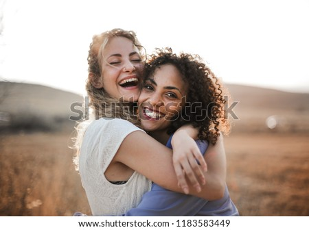 Two female friends having fun in summer. Royalty-Free Stock Photo #1183583449