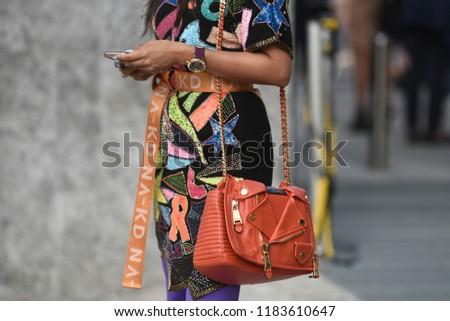 Milan, Italy - September 19, 2018: Street style outfits before ALBERTA FERRETTI fashion show during Milan Fashion Week  - MFWSS19 #1183610647