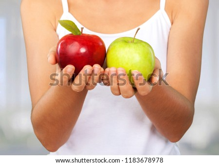 Young woman holding red apple #1183678978