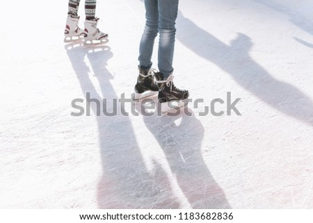 People ride on the skating rink on the ice rink during the Christmas holidays. Sports and fun pastime. #1183682836