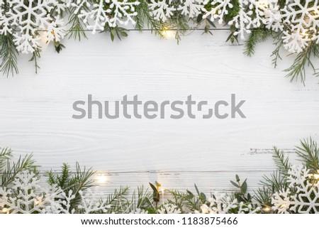 Snowflake and Christmas lights on wooden table