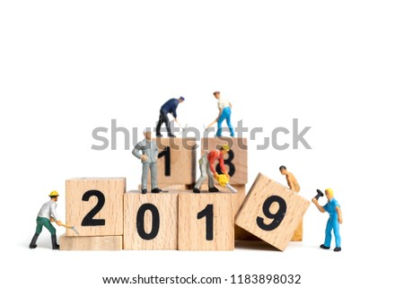 Miniature worker team painting number 2019 on white background , Happy new year 2019 concept #1183898032