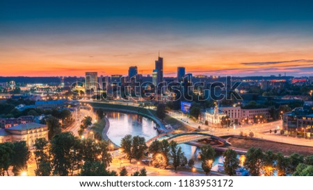 Vilnius, Lithuania, Eastern Europe. Summer Cityscape With Modern Office Buildings Skyscrapers In Business District New City Center Shnipishkes In Night Illuminations During Sunset. Royalty-Free Stock Photo #1183953172