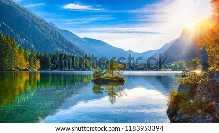 Fantastic autumn sunset of Hintersee lake. Beautiful scene of trees on a rock island. Location: resort Ramsau, National park Berchtesgadener Land, Upper Bavaria, Germany Alps, Europe #1183953394