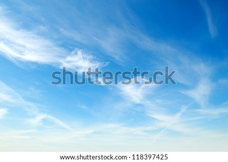 white fluffy clouds in the blue sky #118397425