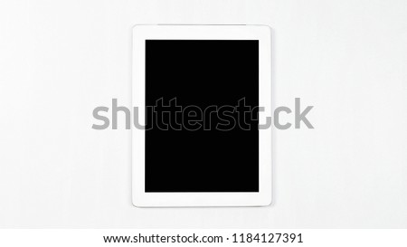 Top view(Flay lay) of white tablet computer isolated with empty blank blank screen on white background view. Technology picture. Front view of business office. Education.