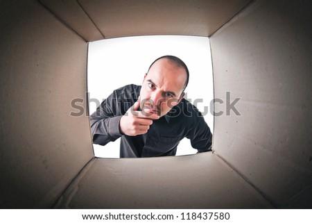 caucasian man look into a cardboard parcel