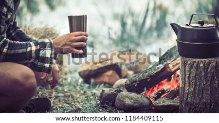the concept of camping the guy on the nature of the fire with tourist facilities #1184409115