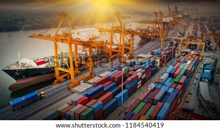 Logistics and transportation of Container Cargo ship and Cargo plane with working crane bridge in shipyard at sunrise, logistic import export and transport industry background #1184540419