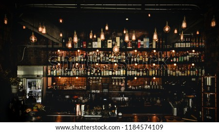 vintage lamps with blurred liquor bar  Royalty-Free Stock Photo #1184574109
